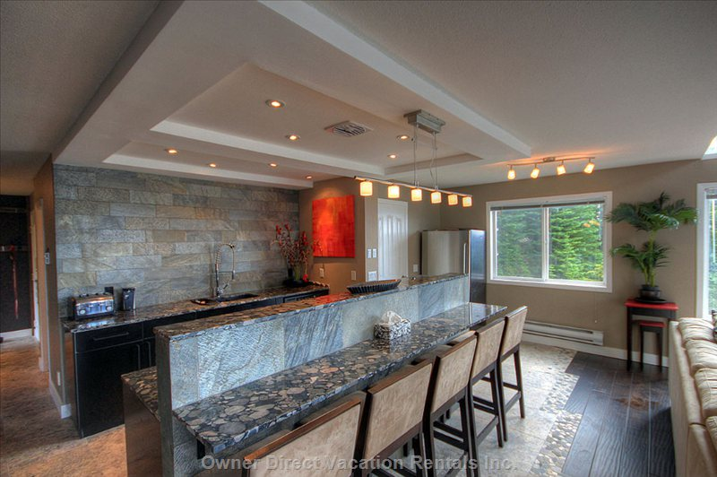 View of the Kitchen - Pebble Granite Counter Tops, Stainless Steel Appliances, Heated Pewter Travertine Flooring