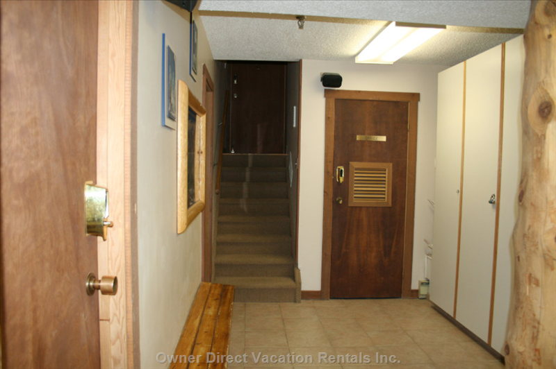 Foyer - There Are Cupboards Equipped with  Games, Movies, Paddles for Ping Pong Table, Paddles for Air Hockey, Extra Towels for Hot Tubbing.  There is Also a Cupboard with Vacuum, Mop and Broom.  There is a Drying Room with a Small Laundry Sink.