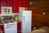 Kitchen has a Microwave, Coffee Maker, Coffee Grinder, Toaster, Utensils and Spices for Preparing Food.