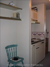 Galley Kitchen. Small Fridge, Burner Stove and Sink
