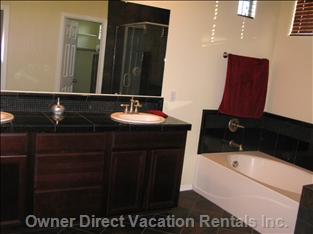 Master Bathroom has Double Sinks, Large Tub, Stone Walk-in Shower, Separate Room for Toilet