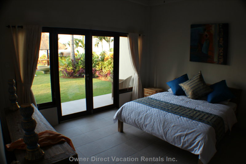 The Downstairs Bedrooms Have their Own Private Patios and Large Doors to Open the Rooms to the Beautiful Garden.