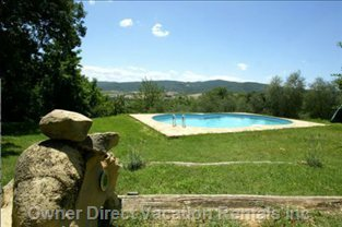 The Pool at the Borgo Overlooking the Olive Orchard and the Surrounding Valley
