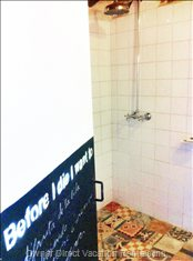 A Newly Renovated Shower, Decorated with Antique Tiles