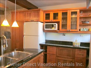 Kitchen with a Large Fridge, Fully Equipped, Ample Storage, Stove (with Oven)