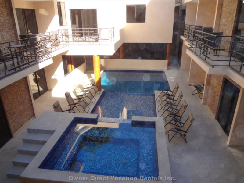 Spa, Beach Pool and Standard Pool in Center of Courtyard within the inside Area.