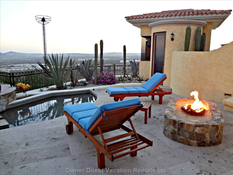 Outdoor Living and Kitchen Area  Sauna and Steam Room Building in Background and Firepit