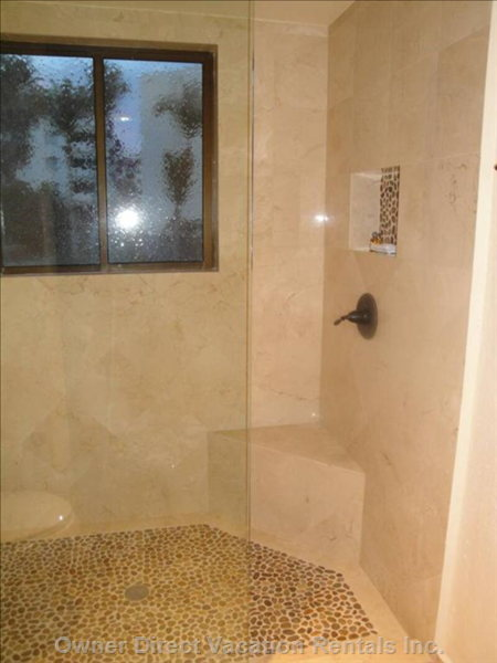 Brand New Marble & Stone Bathrooms Have Seamless Showers, New Fixtures, more!