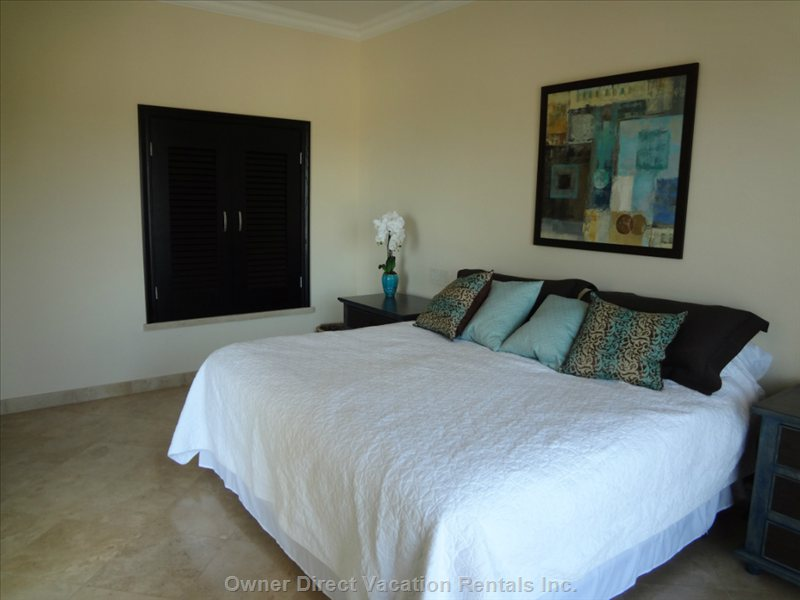 Beautifully Decorated Master Bedroom with 2 Separate Views to Pool and Ocean---Sliding Walkouts to both
