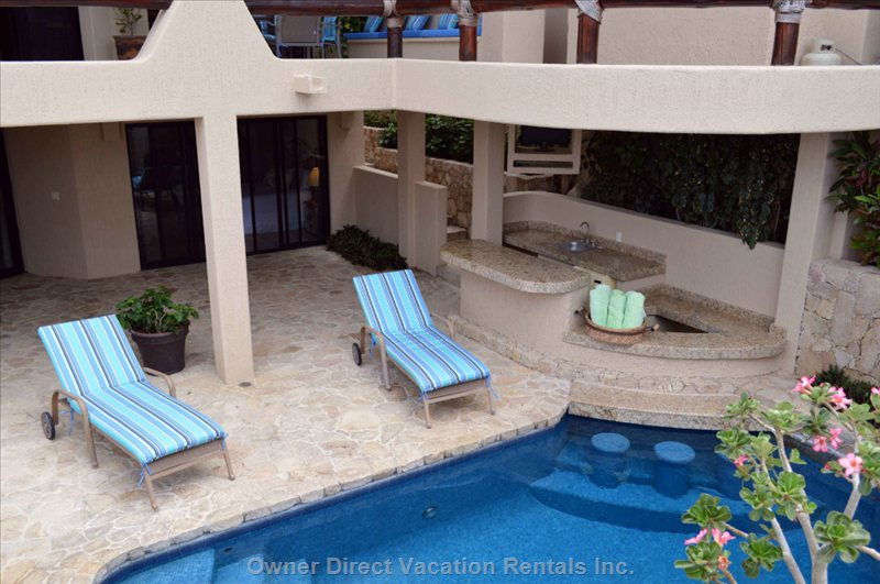 View of the Swim up Pool Bar, Tv and Wet Bar