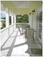 Large Rear Veranda - one of Two Rear Verandas Overlooking the Beautiful Caribbean Sea.  this Veranda has Lounge Chair, Outdoor Patio Table and Chairs.  Sip on something Cold While you Enjoy the Lovely Nevis Sunset over the Sea, Or Just Gaze at the Calming Sea with Neighboring St. Kitts in the Background.