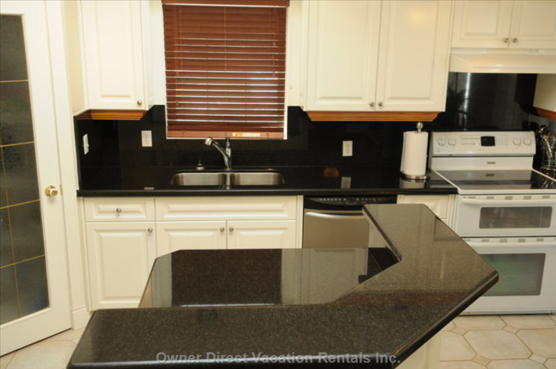 Kitchen with Granite Counter Top and Walk in Pantry