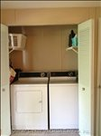 Washer and Dryer  in Enclosed Area of Kitchen