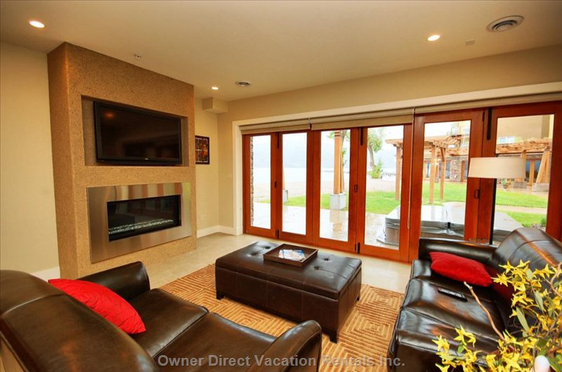 Living Room - Looking out at the Beach and Patio, Note the Accordion Doors which Open the Full Width of the Room.
