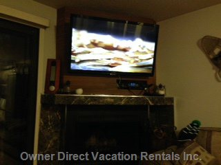 Brand New 50 Inch Lcd Tv over Fireplace