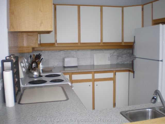 Nice Kitchen to Work In. Open to your Guests for Socializing