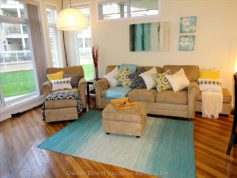 Fresh Beachy Feel Makes this Condo Feel like your on Vacation. Patio Doors Lead to Pool Access.