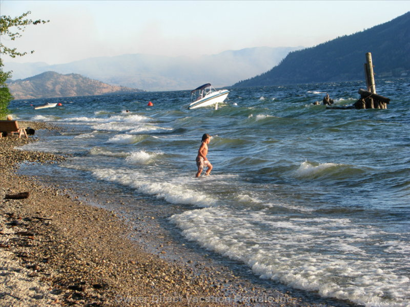 Excitement in the Surf of Okanagan Lake Steps from the Cottage
