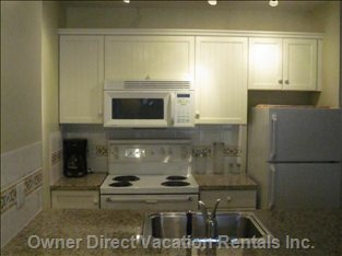 Fully Equipped Kitchen with Granite Surfaces