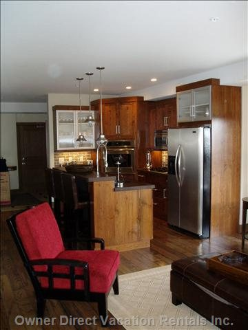 Fully Stocked Kitchen with Island and 3 Leather Bar Stools