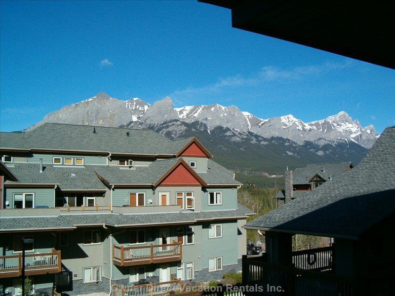 Mt. Rundle Stretches from Canmore to Banff along the Bow Valley.  Cougar Lodge Hot Tub is Just Steps Away
