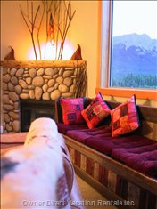Cozy up on Antique Barn-Wood Bench to River-Stone Fireplace