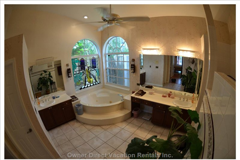 First Floor:Master Bathroom , Jetted Tub, Walk in Shower, his & hers Vanities