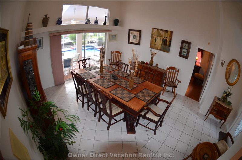 First Floor:Dining Room W. Table & Chairs  for 10 People. Glass Sliding Doors to Pool Area.