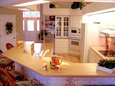 Large Fully Equipped Kitchen with Breakfast Bar.