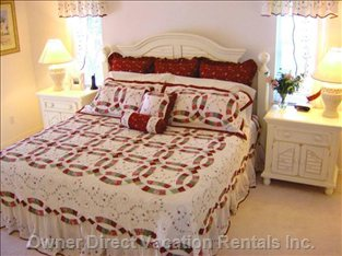 Master Bedroom with King Size Bed and Two Large Walk in Closets.