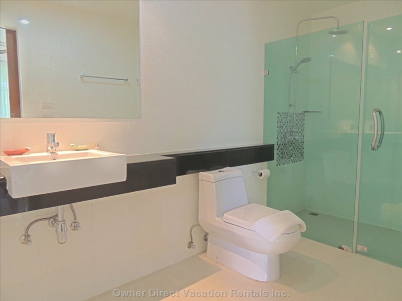 Modern Ensuite Bathroom with Shower - Similar to but May Not be Exact Unit.