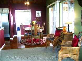 Comfortable Dining Area with Entrance to Lanai and Barbeque