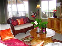 Richly and Warm Furnished Living Room with Ocean Views Abound!