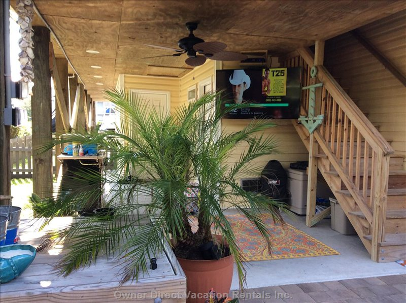 You Can Enjoy the Outside Breezes on the Patio and Watch your Favorite Show with the Flatscreen Tv