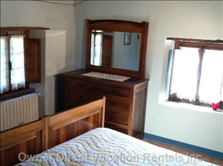 Main Bedroom  - Large Comfortable Bed with Double Aspect Views over Gardens.