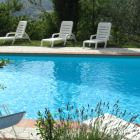 Poolside - the Pool Offers a Pergola and Alongside There Are Sunbeds with Views of the Valley.