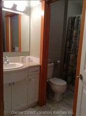 2nd Bathroom with Separating Pocket Door to the Toilet, Bathtub and Shower.