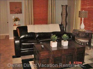 "Living Room on Main Floor with Queen Sofa Bed & 42"" Plasma &"
