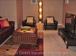 "Lower Level Living Room with Queen Sofa Bed & 50"" Plasma TV"