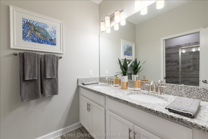 Enjoy Getting Ready in the Downstairs Private, King Bath: 2 Sinks, Walk in Shower, Hair Dryer, Makeup Mirror, Shampoo & Soaps Included.