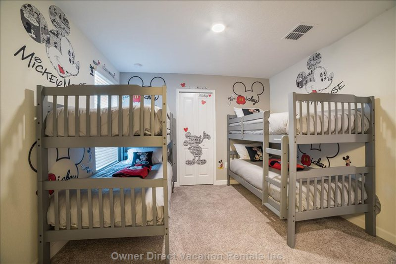 "Delight the Littles with the Mickey Mouse Bunk Room. Sleeps 4 Kids with 40"" Tv. Shares Bath with Upstairs Master Suite 3."