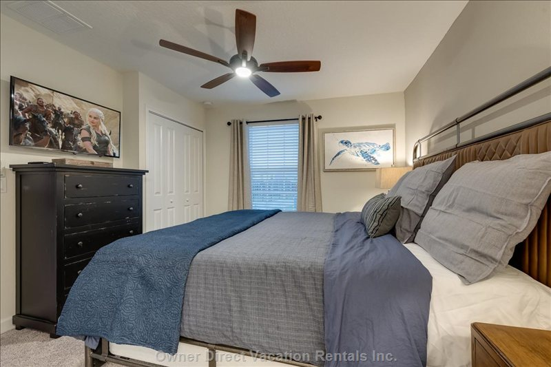 "Sink into Upstairs Master Suite 3's King Bed with 40"" Tv and Shared Attached Bath. Bedroom Shares Bath with Mickey Bunk Room."
