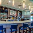 Spend Happy Hour at the Oasis Club Bar
