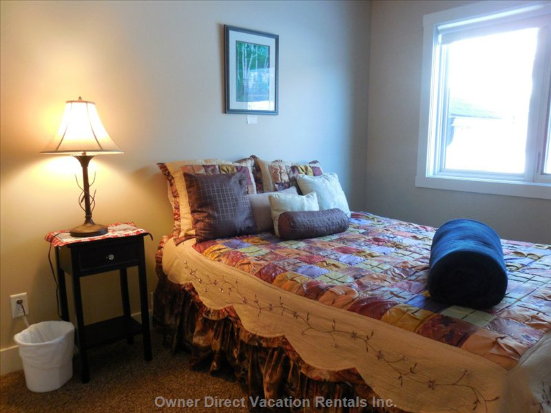 Rest & Relax in the Comfort of this Peaceful Guest Bedroom with Closet, Extra Bedding and Linens.