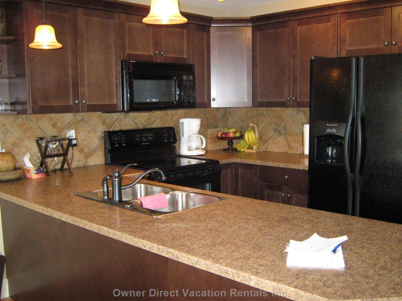 Cozy Kitchen with Dishwasher & Microwave, Frig Front Water/Ice Dispenser, Comes Equipped with Dishes & Cookware for your Convenience.