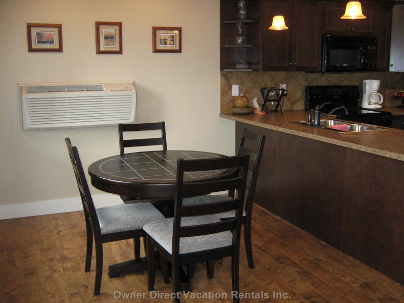 Dining Area beside Kitchen, Table Extends to Seat 6 with 2 Extra Chairs. A Perfect Place to Meet & Share a Meal Together.