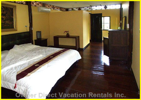 King Size Bed - each House has 2 Units that Are Able to be Rented, this is one of the Bedrooms.