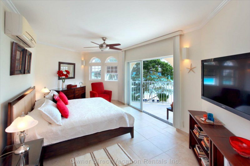 Master Bedroom with Access to Balcony.   Rates Vary by Date, so Please Check our Calendar.
