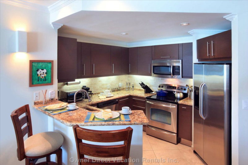 Kitchen with Fridge, Stove, Dish-Washer, Coffee Maker and Microwave Oven.