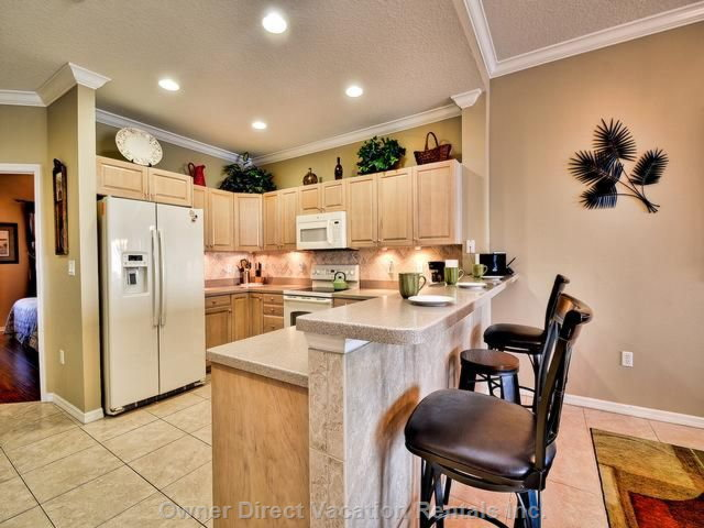 Kitchen with all Appliances /Table Ware and Utentils.